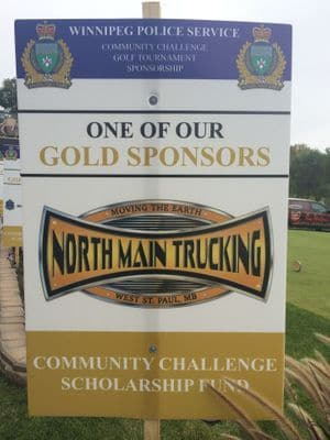 Picture of a sign that says Winnipeg Police Services Golf Tournament - North Main Trucking Gold Sponsor